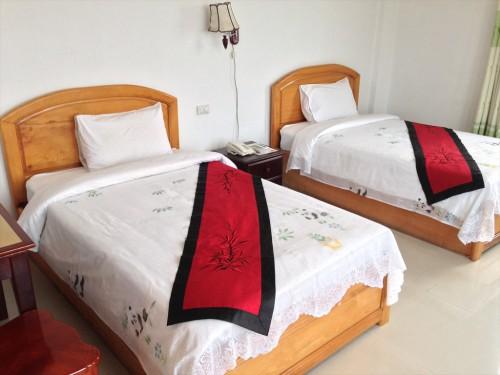 ドウアンプラセウスホテル(Douangpraseuth Hotel)のStandard Twinルームのベッドです。